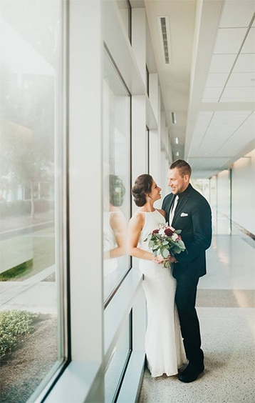 Bride and groom in foyer at the FORUM Events Center, wedding venue