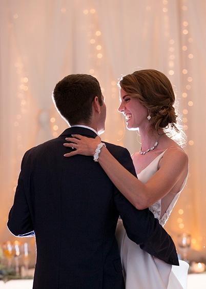 Bride and groom dancing at FORUM Events Center, wedding venue